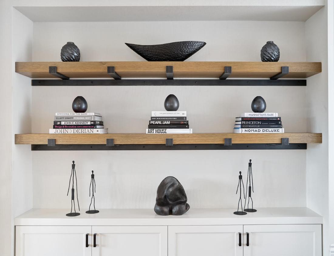 family-room-white-and-wood-shelves-books-art-decor