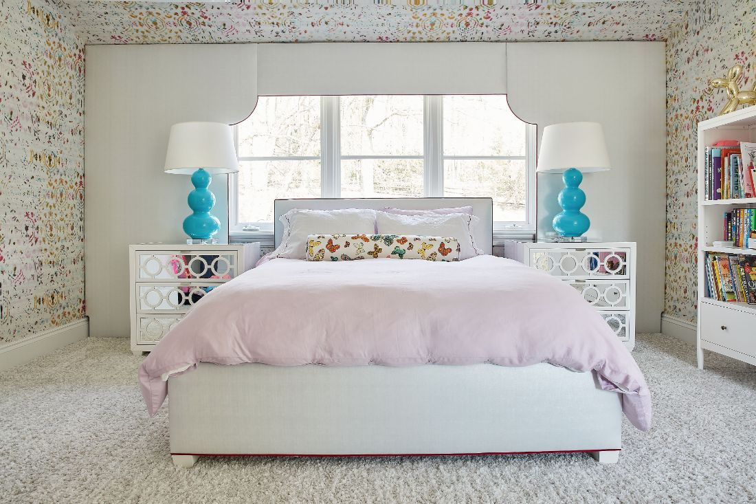 girls-bedroom-symmetry-blue-lamps-pink-comforter