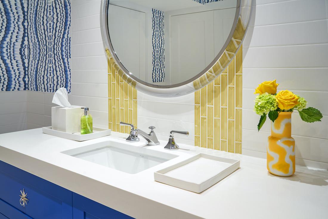 bathroom-vanity-yellow-and-white-tile-backsplash